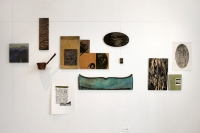 2006. Installation with woodcuts, cutting board and found objects. 10